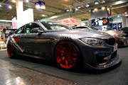 BMW F82 M4 At Essen Motorshow Candy Red Rims 01