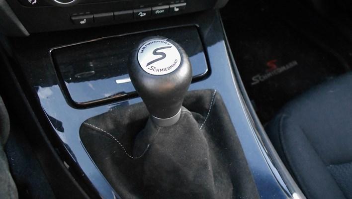 Schmiedmann Motorsport gear emblem.
